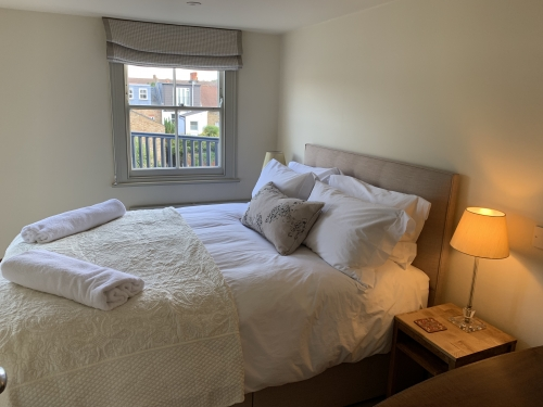 The top floor bedroom has a kind-sized bed