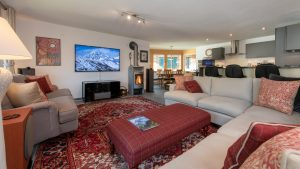 """Open plan living room with wood burning stove & 65"""" home cinema system"""