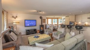 """All our vacation homes have been luxuriously furnished - The Mischabel has a wood burning stove and 65"""" home cinema system"""